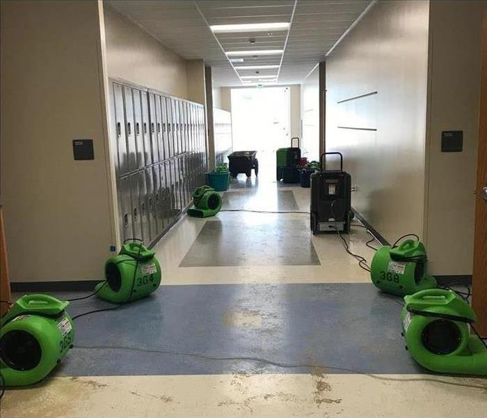 Air mover placed on a hallway school